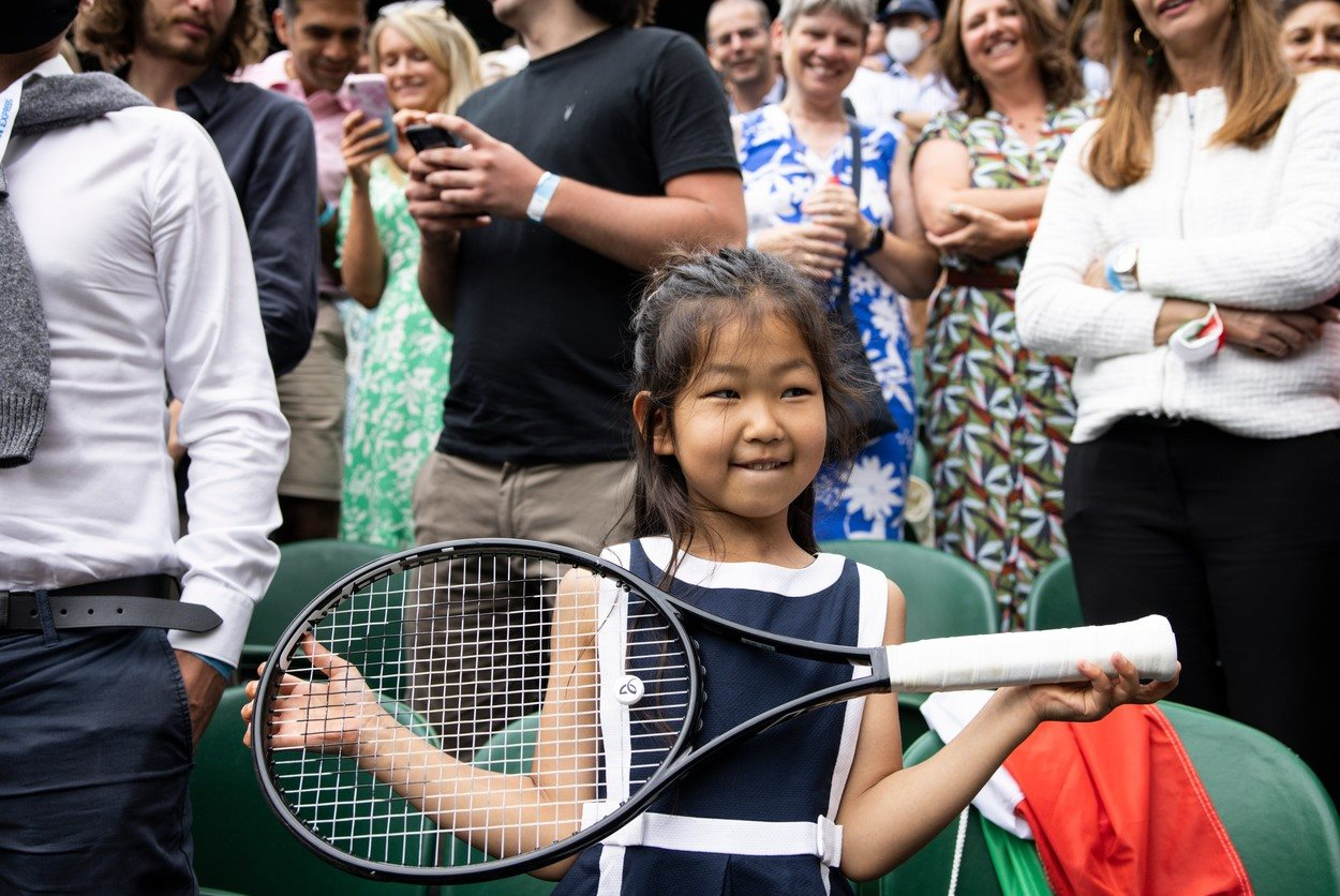 July 11, 2021, London, England, UK - Novak Djokovic celebrates his victory and gives a young fans his racket © Andy Hooper/Daily Mail/dmg media Licensing,Image: 621065326, License: Rights-managed, Restrictions: , Model Release: no, Credit line: Andy Hooper / Solo / Profimedia